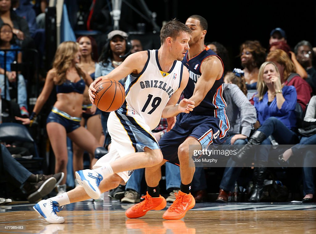 <a gi-track='captionPersonalityLinkClicked' href=/galleries/search?phrase=Beno+Udrih&family=editorial&specificpeople=202616 ng-click='$event.stopPropagation()'>Beno Udrih</a> #19 of the Memphis Grizzlies dribbles against the Charlotte Bobcats on March 8, 2014 at FedExForum in Memphis, Tennessee.