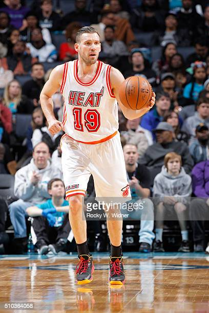 Beno Udrih of the Miami Heat brings the ball up the court against the Charlotte Hornets on February 5 2016 at Time Warner Cable Arena in Charlotte...