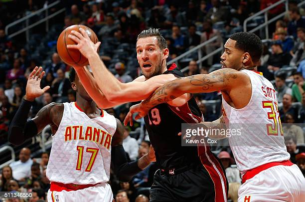 Beno Udrih of the Miami Heat drives against Mike Scott of the Atlanta Hawks at Philips Arena on February 19 2016 in Atlanta Georgia NOTE TO USER User...