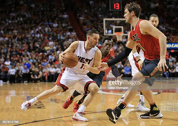 Beno Udrih of the Miami Heat drives on Tiago Splitter of the Atlanta Hawks during a game at American Airlines Arena on January 31 2016 in Miami...