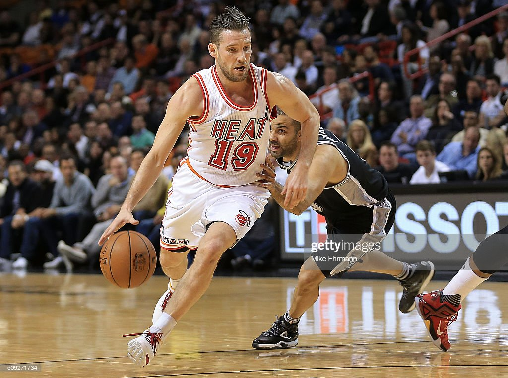 <a gi-track='captionPersonalityLinkClicked' href=/galleries/search?phrase=Beno+Udrih&family=editorial&specificpeople=202616 ng-click='$event.stopPropagation()'>Beno Udrih</a> #19 of the Miami Heat drives on <a gi-track='captionPersonalityLinkClicked' href=/galleries/search?phrase=Tony+Parker&family=editorial&specificpeople=160952 ng-click='$event.stopPropagation()'>Tony Parker</a> #9 of the San Antonio Spurs during a game at American Airlines Arena on February 9, 2016 in Miami, Florida.
