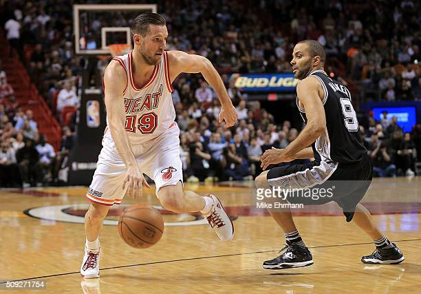 Beno Udrih of the Miami Heat drives on Tony Parker of the San Antonio Spurs during a game at American Airlines Arena on February 9 2016 in Miami...