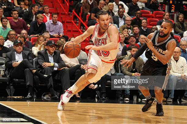 Beno Udrih of the Miami Heat drives to the basket against Patty Mills of the San Antonio Spurs on February 9 2016 at American Airlines Arena in Miami...