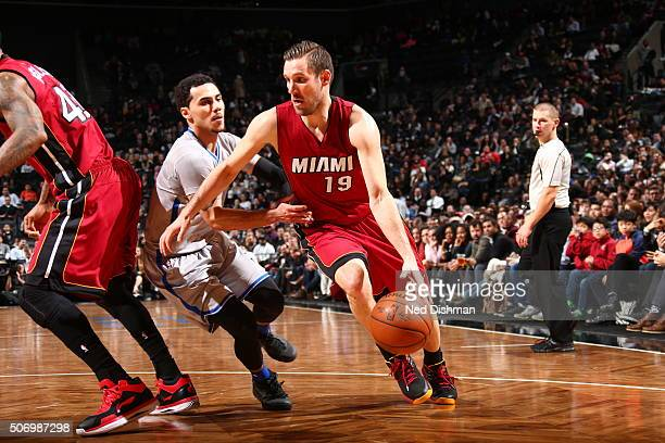 Beno Udrih of the Miami Heat drives to the basket against Shane Larkin of the Brooklyn Nets on January 26 2016 at Barclays Center in the Brooklyn...