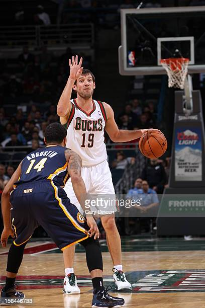Beno Udrih of the Milwaukee Bucks calls a play while DJ Augustin of the Indiana Pacers defends him during the NBA game on November 14 2012 at the BMO...
