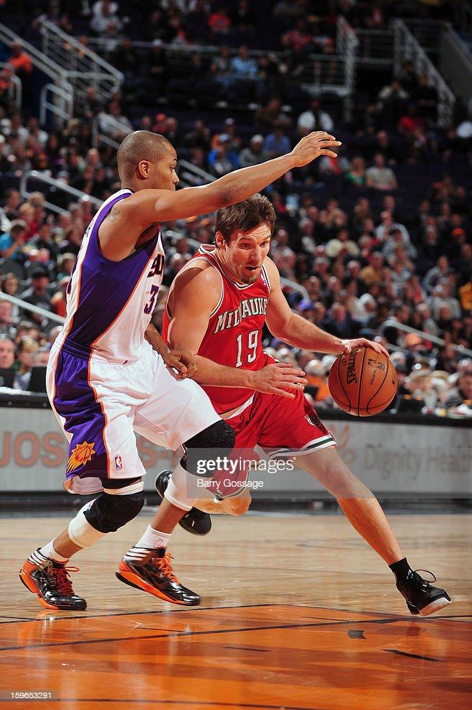 Beno Udrih #19 of the Milwaukee Bucks drives hard to the basket against the Phoenix Suns on January 17, 2013 at U.S. Airways Center in Phoenix, Arizona.