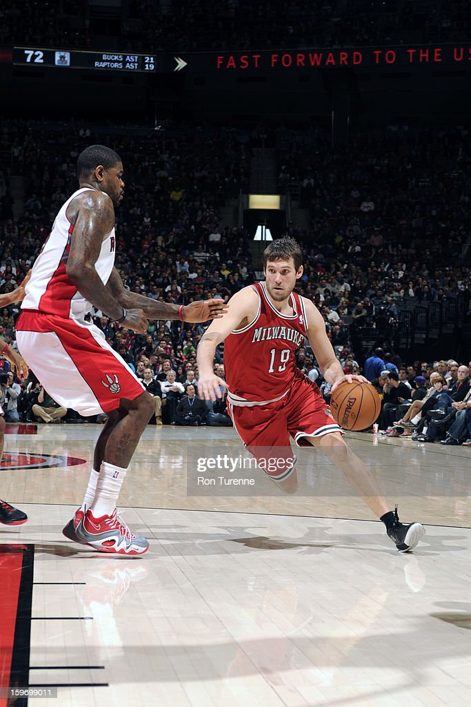 <a gi-track='captionPersonalityLinkClicked' href=/galleries/search?phrase=Beno+Udrih&family=editorial&specificpeople=202616 ng-click='$event.stopPropagation()'>Beno Udrih</a> #19 of the Milwaukee Bucks drives to the basket against <a gi-track='captionPersonalityLinkClicked' href=/galleries/search?phrase=Amir+Johnson&family=editorial&specificpeople=556786 ng-click='$event.stopPropagation()'>Amir Johnson</a> #15 of the Toronto Raptors during the game on January 13, 2013 at the Air Canada Centre in Toronto, Ontario, Canada.