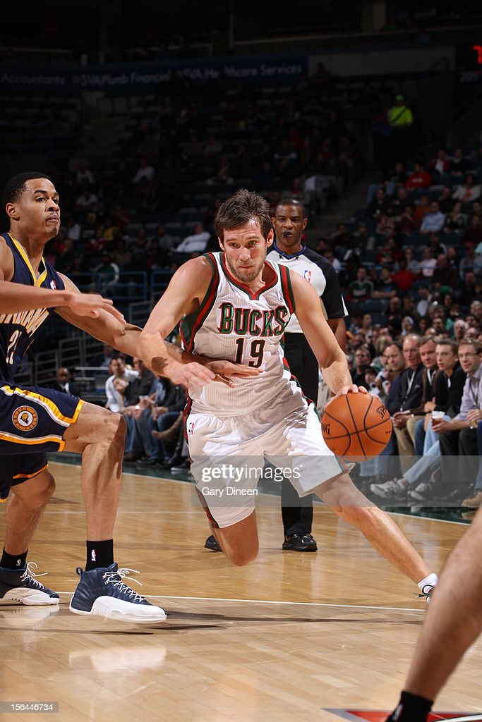 <a gi-track='captionPersonalityLinkClicked' href=/galleries/search?phrase=Beno+Udrih&family=editorial&specificpeople=202616 ng-click='$event.stopPropagation()'>Beno Udrih</a> #19 of the Milwaukee Bucks drives to the basket against <a gi-track='captionPersonalityLinkClicked' href=/galleries/search?phrase=Gerald+Green&family=editorial&specificpeople=644655 ng-click='$event.stopPropagation()'>Gerald Green</a> #25 of the Indiana Pacers during the NBA game on November 14, 2012 at the BMO Harris Bradley Center in Milwaukee, Wisconsin.