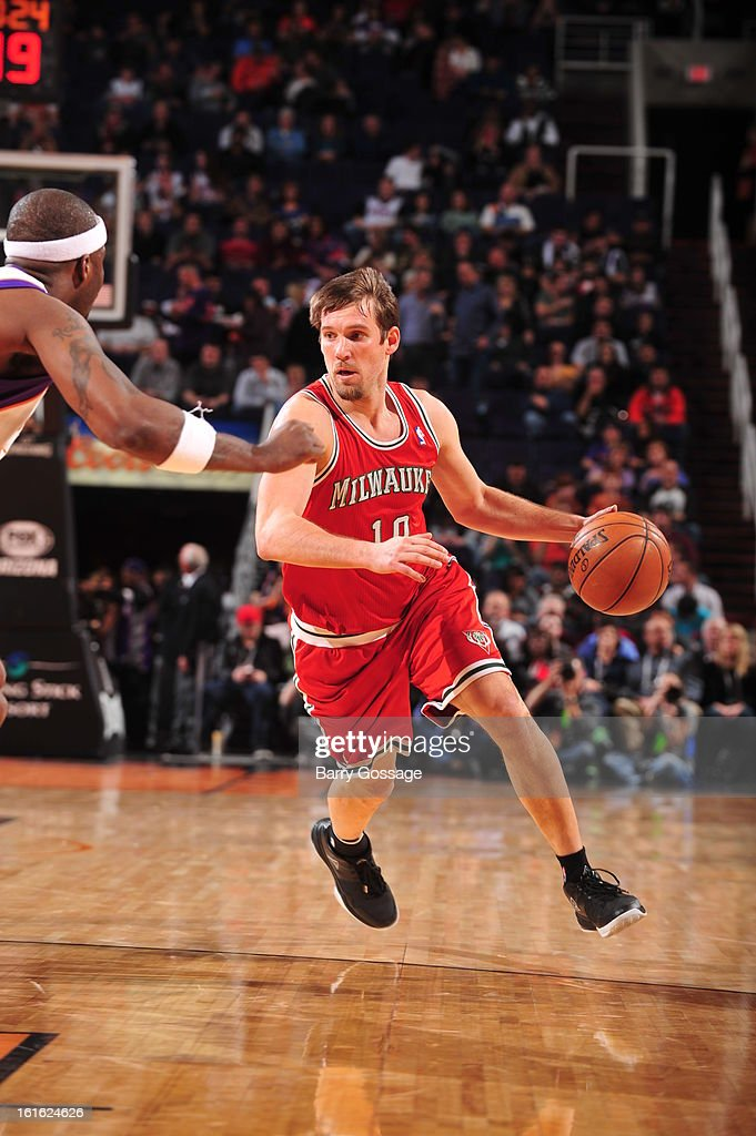 <a gi-track='captionPersonalityLinkClicked' href=/galleries/search?phrase=Beno+Udrih&family=editorial&specificpeople=202616 ng-click='$event.stopPropagation()'>Beno Udrih</a> #19 of the Milwaukee Bucks drives to the basket against the Phoenix Suns on January 17, 2013 at U.S. Airways Center in Phoenix, Arizona.