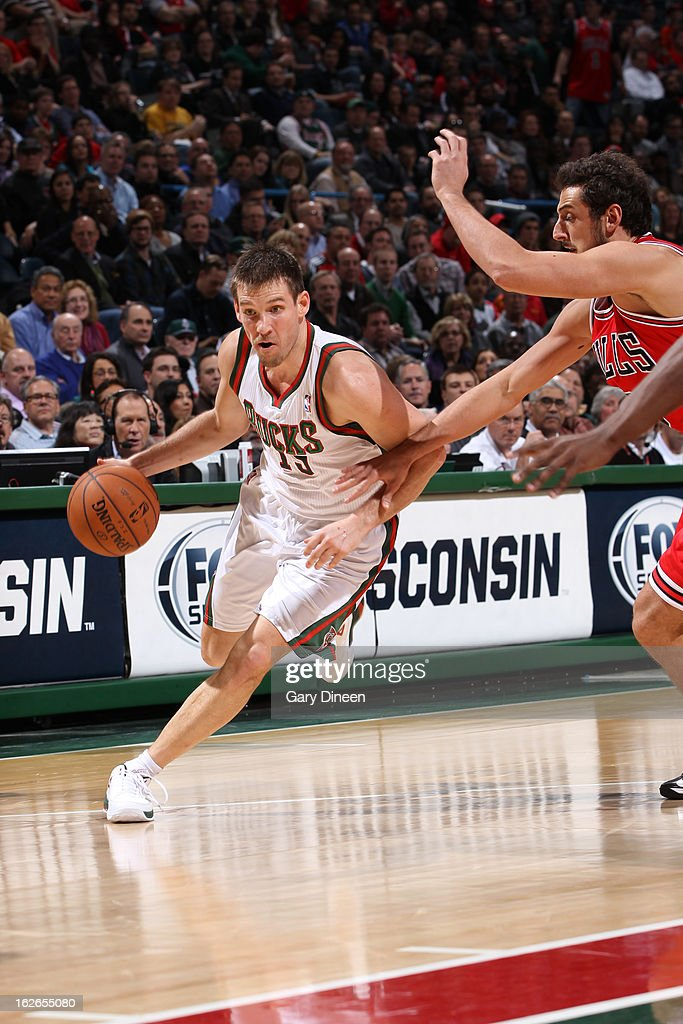 <a gi-track='captionPersonalityLinkClicked' href=/galleries/search?phrase=Beno+Udrih&family=editorial&specificpeople=202616 ng-click='$event.stopPropagation()'>Beno Udrih</a> #19 of the Milwaukee Bucks drives to the basket against the Chicago Bulls on January 30, 2013 at the BMO Harris Bradley Center in Milwaukee, Wisconsin.