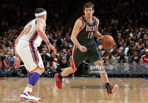 Beno Udrih of the Milwaukee Bucks in action against Mike Bibby of the New York Knicks on March 26 2012 at Madison Square Garden in New York City The...