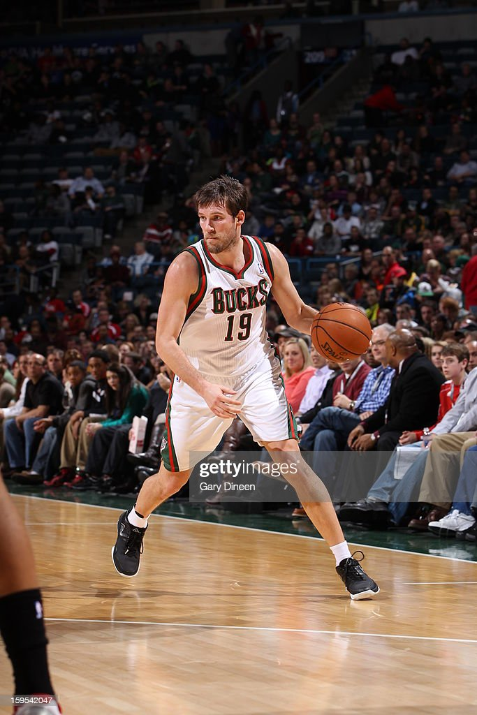 <a gi-track='captionPersonalityLinkClicked' href=/galleries/search?phrase=Beno+Udrih&family=editorial&specificpeople=202616 ng-click='$event.stopPropagation()'>Beno Udrih</a> #19 of the Milwaukee Bucks looks to drive to the basket against the Detroit Pistons on January 11, 2013 at the BMO Harris Bradley Center in Milwaukee, Wisconsin.