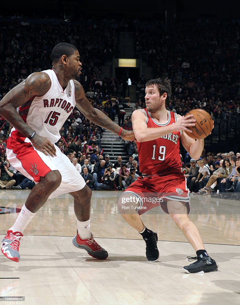 <a gi-track='captionPersonalityLinkClicked' href=/galleries/search?phrase=Beno+Udrih&family=editorial&specificpeople=202616 ng-click='$event.stopPropagation()'>Beno Udrih</a> #19 of the Milwaukee Bucks looks to pass the ball against <a gi-track='captionPersonalityLinkClicked' href=/galleries/search?phrase=Amir+Johnson&family=editorial&specificpeople=556786 ng-click='$event.stopPropagation()'>Amir Johnson</a> #15 of the Toronto Raptors on January 13, 2013 at the Air Canada Centre in Toronto, Ontario, Canada.