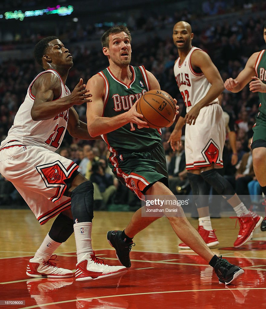 <a gi-track='captionPersonalityLinkClicked' href=/galleries/search?phrase=Beno+Udrih&family=editorial&specificpeople=202616 ng-click='$event.stopPropagation()'>Beno Udrih</a> #19 of the Milwaukee Bucks moves Past <a gi-track='captionPersonalityLinkClicked' href=/galleries/search?phrase=Jimmy+Butler+-+Basketballer&family=editorial&specificpeople=9860567 ng-click='$event.stopPropagation()'>Jimmy Butler</a> #21 of the Chicago Bulls at the United Center on November 26, 2012 in Chicago, Illinois. The Bucks defeated the Bulls 93-92.
