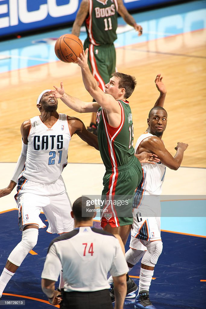 <a gi-track='captionPersonalityLinkClicked' href=/galleries/search?phrase=Beno+Udrih&family=editorial&specificpeople=202616 ng-click='$event.stopPropagation()'>Beno Udrih</a> #19 of the Milwaukee Bucks shoots against <a gi-track='captionPersonalityLinkClicked' href=/galleries/search?phrase=Hakim+Warrick&family=editorial&specificpeople=210640 ng-click='$event.stopPropagation()'>Hakim Warrick</a> #21 of the Charlotte Bobcats at the Time Warner Cable Arena on November 19, 2012 in Charlotte, North Carolina.