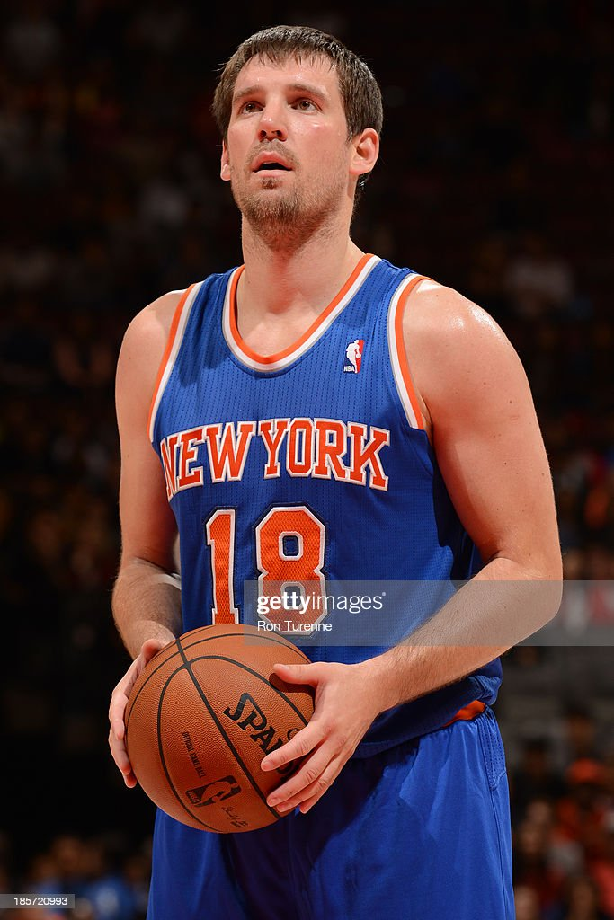 <a gi-track='captionPersonalityLinkClicked' href=/galleries/search?phrase=Beno+Udrih&family=editorial&specificpeople=202616 ng-click='$event.stopPropagation()'>Beno Udrih</a> #18 of the New York Knicks attempts a foul shot against the Toronto Raptors during the game on October 11, 2013 at the Air Canada Centre in Toronto, Ontario, Canada.