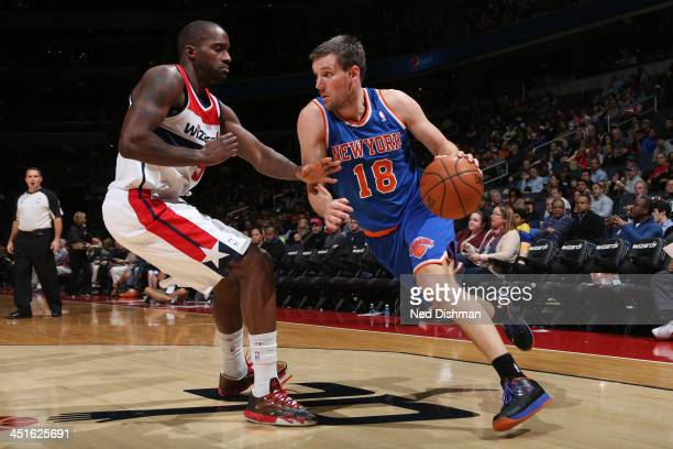 Beno Udrih of the New York Knicks drives against Martell Webster of the Washington Wizards during the game at the Verizon Center on November 23 2013...