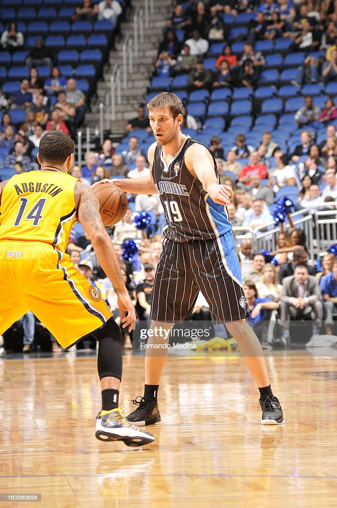 Beno Udrih #19 of the Orlando Magic controls the ball against D.J. Augustin #14 of the Indiana Pacers on March 8, 2013 at Amway Center in Orlando, Florida.