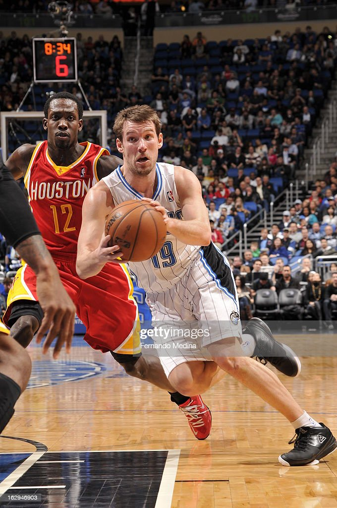 Beno Udrih #19 of the Orlando Magic drives to the hoop and does a ball fake against the Houston Rockets during the game on March 1, 2013 at Amway Center in Orlando, Florida.