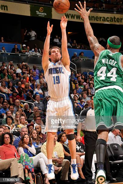 Beno Udrih of the Orlando Magic shoots against Chris Wilcox of the Boston Celtics on April 13 2013 at Amway Center in Orlando Florida NOTE TO USER...
