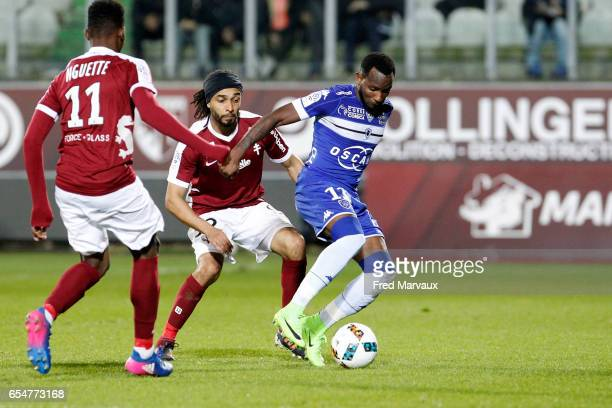 Benoit Assou Ekotto of Metz and Lenny Nangis of Bastia during the Ligue 1 match between Fc Metz and SC Bastia at Stade SaintSymphorien on March 17...