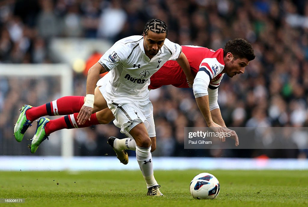 Benoit Assou-Ekotto of Spurs and Olivier Giroud of Arsenal compete for the ball during the Barclays Premier League match between Tottenham Hotspur and Arsenal FC at White Hart Lane on March 3, 2013 in London, England.
