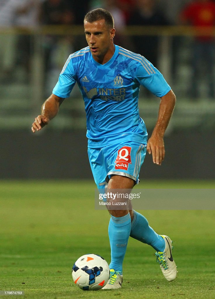 <a gi-track='captionPersonalityLinkClicked' href=/galleries/search?phrase=Benoit+Cheyrou&family=editorial&specificpeople=648473 ng-click='$event.stopPropagation()'>Benoit Cheyrou</a> of Olympique de Marseille in action during the pre-season friendly match between Parma FC and Olympique de Marseille at Stadio Ennio Tardini on July 31, 2013 in Parma, Italy.