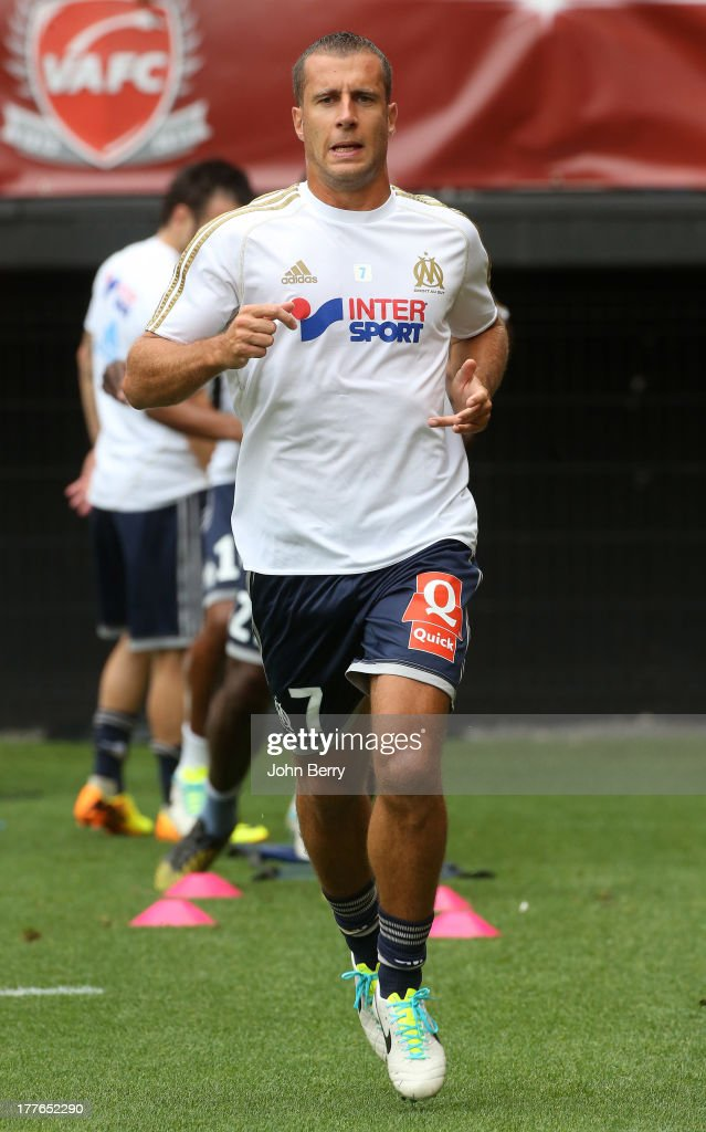 <a gi-track='captionPersonalityLinkClicked' href=/galleries/search?phrase=Benoit+Cheyrou&family=editorial&specificpeople=648473 ng-click='$event.stopPropagation()'>Benoit Cheyrou</a> of OM warms up before the French Ligue 1 match between Valenciennes FC and Olympique de Marseille OM at the Stade du Hainaut stadium on August 24, 2013 in Valenciennes, France.