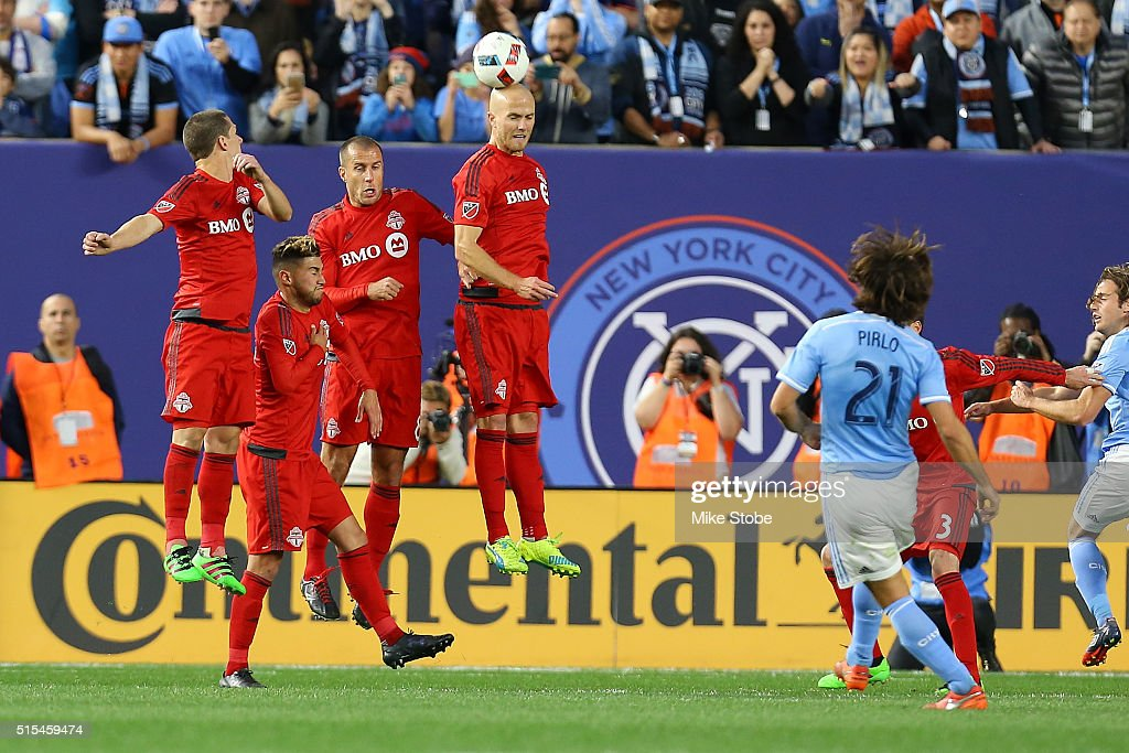 <a gi-track='captionPersonalityLinkClicked' href=/galleries/search?phrase=Benoit+Cheyrou&family=editorial&specificpeople=648473 ng-click='$event.stopPropagation()'>Benoit Cheyrou</a> #8 of Toronto FC defends <a gi-track='captionPersonalityLinkClicked' href=/galleries/search?phrase=Andrea+Pirlo&family=editorial&specificpeople=198835 ng-click='$event.stopPropagation()'>Andrea Pirlo</a> #21 of New York City FC free kick at Yankee Stadium on March 13, 2016 in the Bronx borough of New York City.