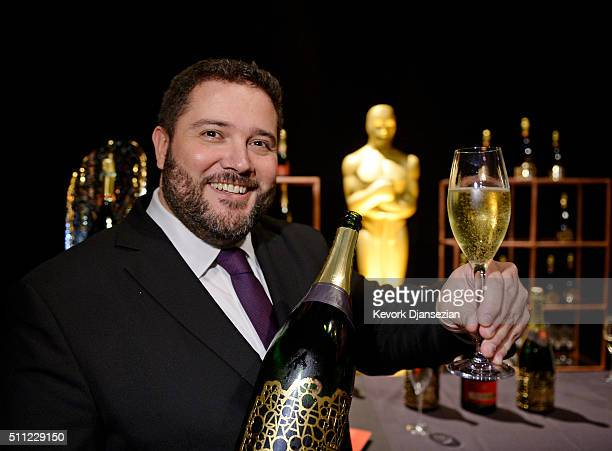Benoit Collard PiperHeidsieck Global Executive Director poses with a exclusive Oscar edition champagne during the 88th Annual Academy Awards...