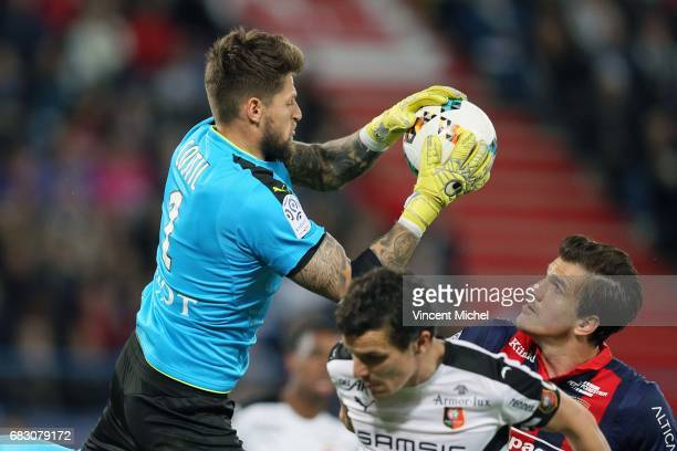 Benoit Costil of Rennes and Ivan Santini of Caen during the Ligue 1 match between SM Caen and Stade Rennais Rennes at Stade Michel D'Ornano on May 14...