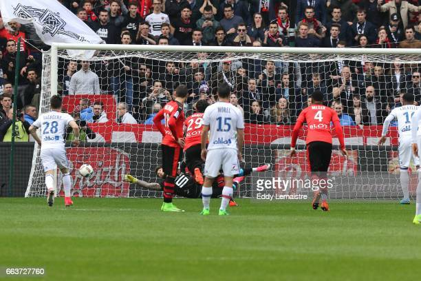 Benoit Costil of Rennes stops the penalty of Alexandre Lacazette of Lyon during the French Ligue 1 match between Rennes and Lyon at Roazhon Park on...