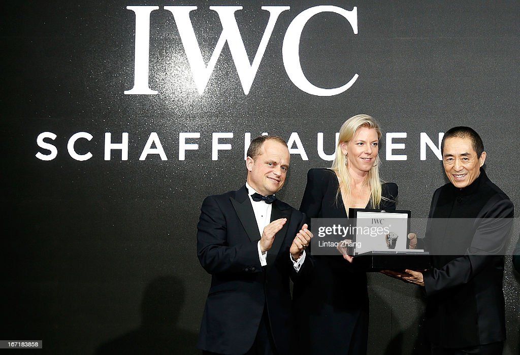 Benoit De Clerck, IWC Managing Director Asia Pacific and Karoline Huber, IWC Director of Marketing & Communications presents the IWC Filmmaker Award to Chinese film director <a gi-track='captionPersonalityLinkClicked' href=/galleries/search?phrase=Zhang+Yimou&family=editorial&specificpeople=211304 ng-click='$event.stopPropagation()'>Zhang Yimou</a> at the exclusive 'For the Love of Cinema' event hosted by Swiss watch manufacturer IWC Schaffhausen in the role as new sponsor of the Beijing International Film Festival, at the Ming Dynasty City Wall on April 22, 2013 in Beijing, China.