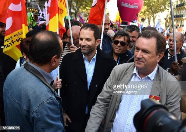 Benoit Hamon and Philippe Martinez Secretary General of the General Confederation of Labour attend a national demonstration against the French...
