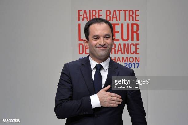 Benoit Hamon salutes voters as he arrvies on stage during his convention to become officially the Socialist Party Presidential candidate at Maison De...