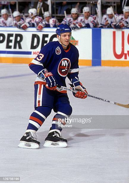 Benoit Hogue of the New York Islanders skates on the ice during an NHL game against the New York Rangers on October 18 1992 at the Madison Square...