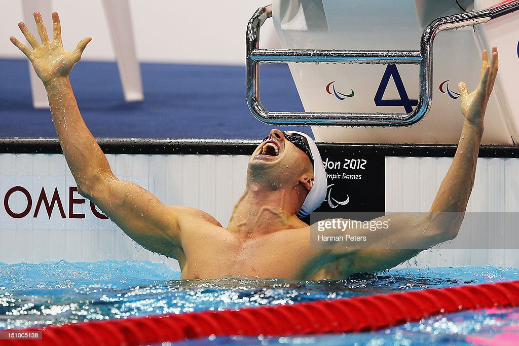 Benoit Huot of Canada celebrates winning the gold in the Men's 200m Individual Medley - SM10 final on day 1 of the London 2012 Paralympic Games at Aquatics Centre on August 30, 2012 in London, England.