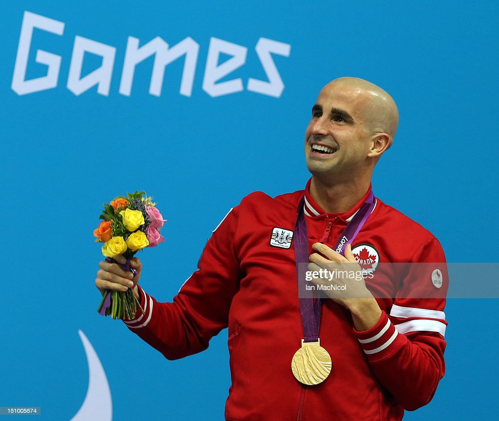 Benoit Huot of Canada celebrates winning the Men's 200IM on day one of the London 2012 Paraympic Games at the Aquatics Centre on August 30, 2012 in London, England.