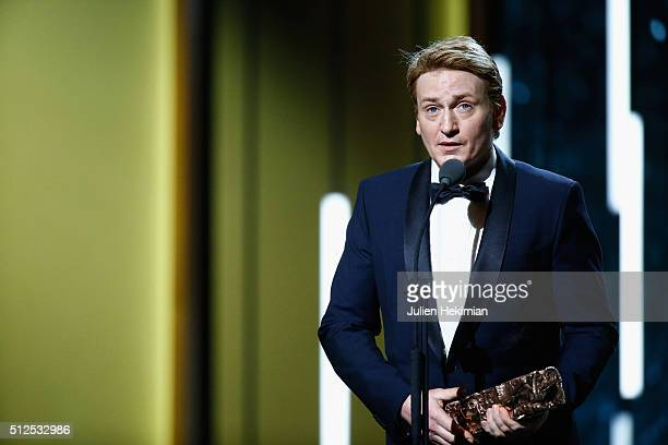 Benoit Magimel receives an award for the best actor in supporting role in 'La tete haute' stage during The Cesar Film Award 2016 at Theatre du...