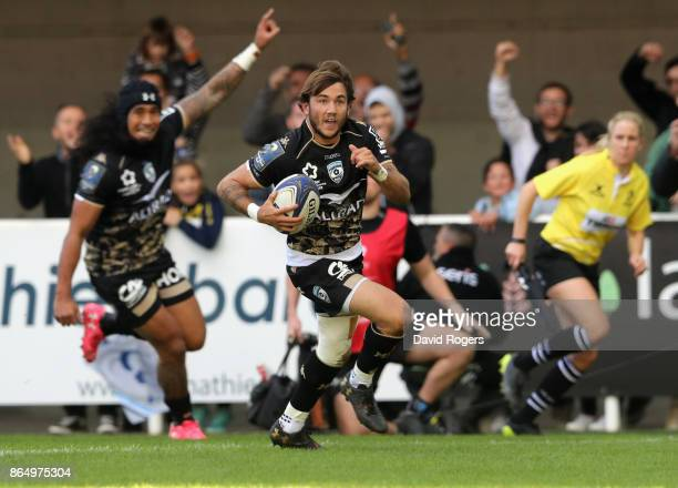 Benoit Paillaugue of Montpellier breaks clear to score their second try during the European Rugby Champions Cup match between Montpellier and Exeter...