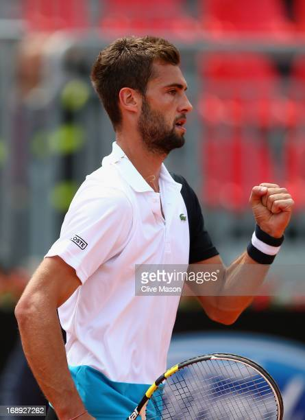Benoit Paire of France celebrates winning a point during his quarter final match against Marcel Granollers of Spain on day six of the Internazionali...