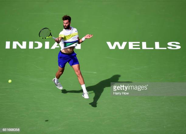 Benoit Paire of France hits a forehand in a straight set loss to Taylor Fritz at Indian Wells Tennis Garden on March 10 2017 in Indian Wells...