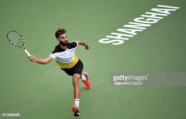 TOPSHOT Benoit Paire of France hits a return against David Goffin of Belgium during their men's singles match at the Shanghai Masters tennis...
