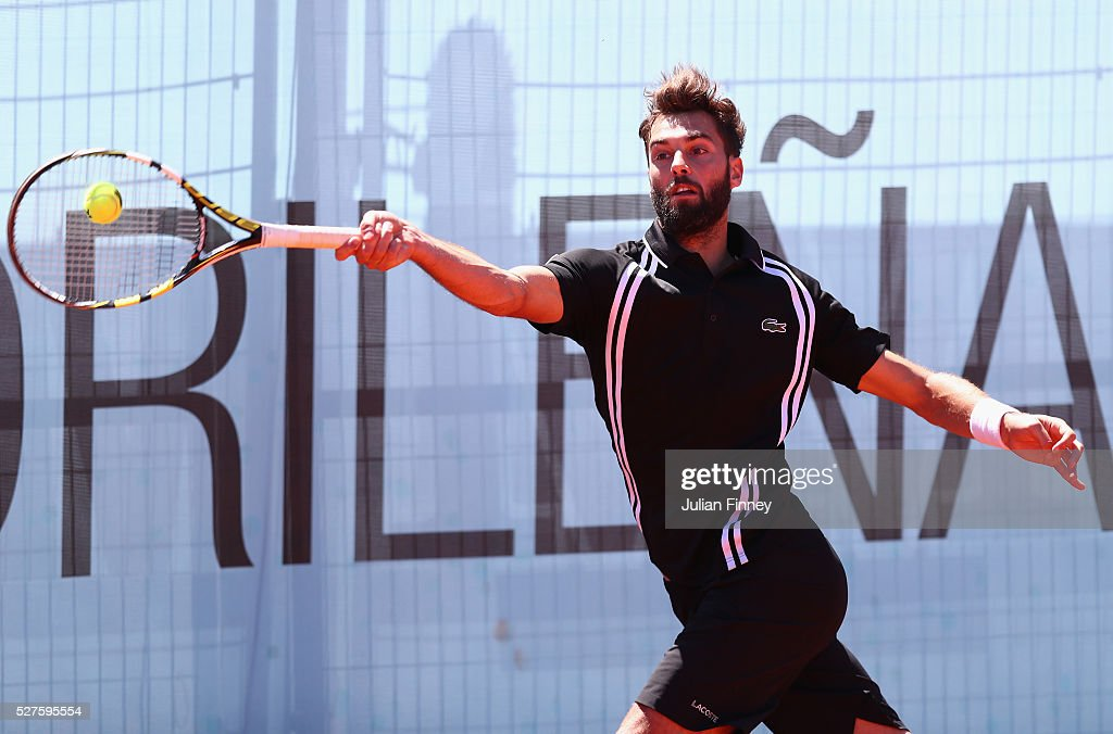 <a gi-track='captionPersonalityLinkClicked' href=/galleries/search?phrase=Benoit+Paire&family=editorial&specificpeople=6999938 ng-click='$event.stopPropagation()'>Benoit Paire</a> of France in action against Jack Sock of USA during day four of the Mutua Madrid Open tennis tournament at the Caja Magica on May 03, 2016 in Madrid, Spain.