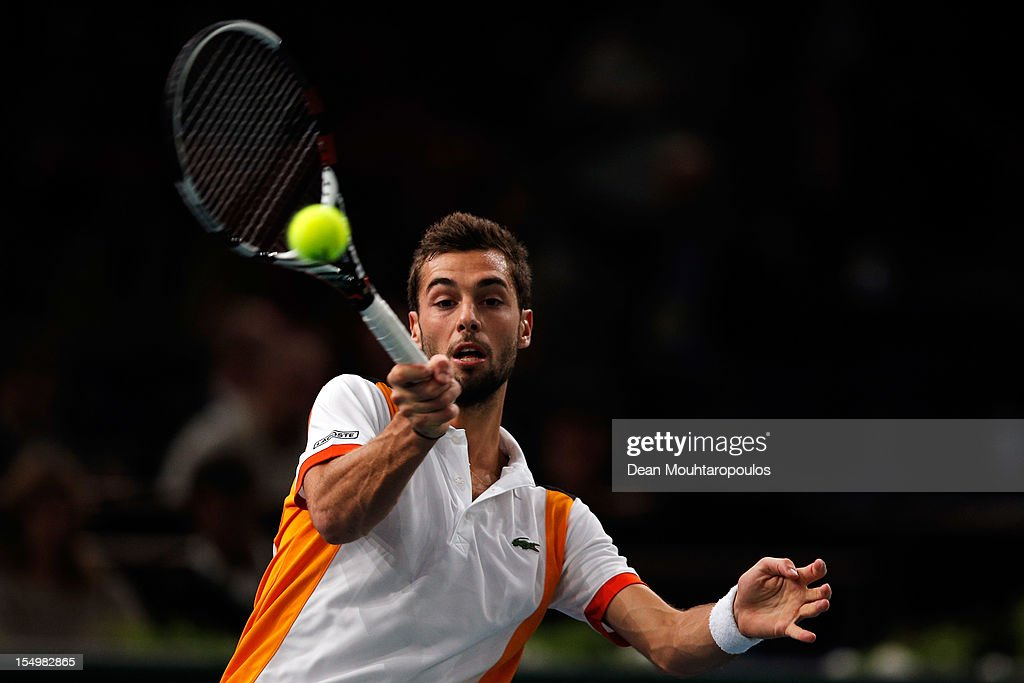 <a gi-track='captionPersonalityLinkClicked' href=/galleries/search?phrase=Benoit+Paire&family=editorial&specificpeople=6999938 ng-click='$event.stopPropagation()'>Benoit Paire</a> of France in action against Pablo Andujar of Spain during day 1 of the BNP Paribas Masters at Palais Omnisports de Bercy on October 29, 2012 in Paris, France.