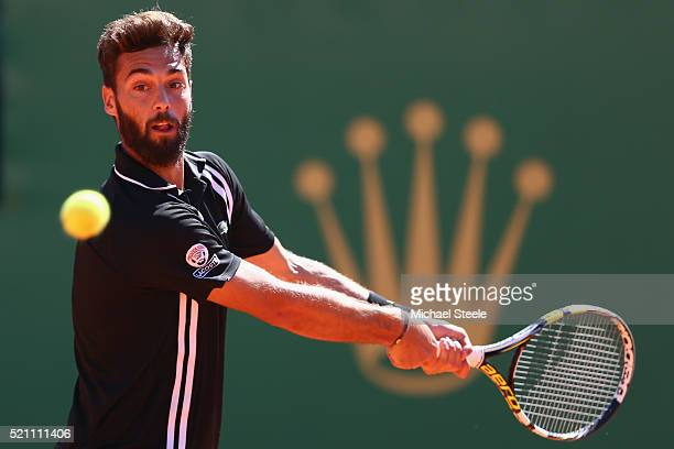 Benoit Paire of France makes a backhand return during his match against Andy Murray of Great Britain lBenoit Paire of France during day five of the...
