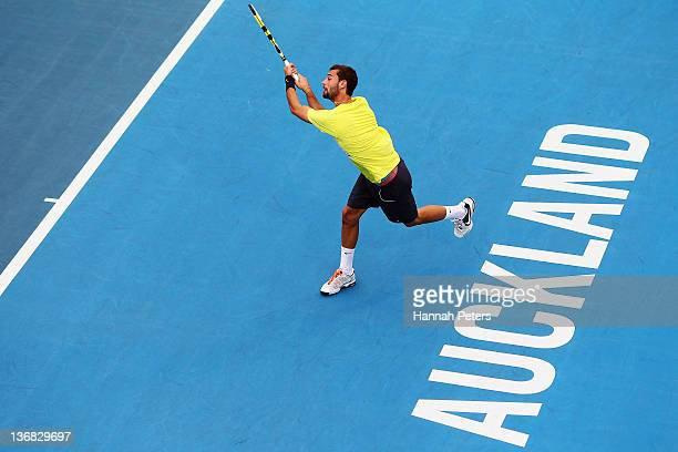 Benoit Paire of France plays a backhand against Olivier Rochus of Belgium during day four of the 2012 Heineken Open at ASB Tennis Centre on January...