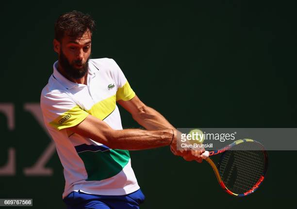 Benoit Paire of France plays a backhand against Tommy Haas of Germany in his first round match on day three of the Monte Carlo Rolex Masters at...
