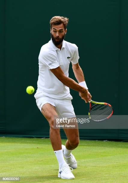 Benoit Paire of France plays a backhand during the Gentlemen's Singles first round match against Rogerio Dutra Silva of Brazil on day one of the...