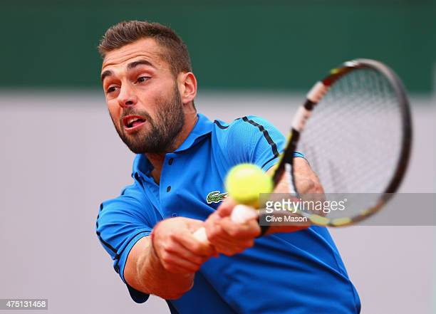 Benoit Paire of France plays a backhand in his Men's Singles match against Tomas Berdych of Czech Republic on day six of the 2015 French Open at...